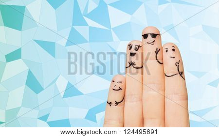gesture, family, people and body parts concept - close up of four fingers with smiley faces over blue low poly texture background,