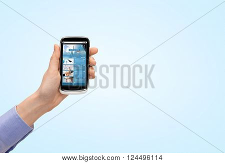 people, business, mass media, internet and technology concept - close up of woman hand with smartphone with news web page on screen