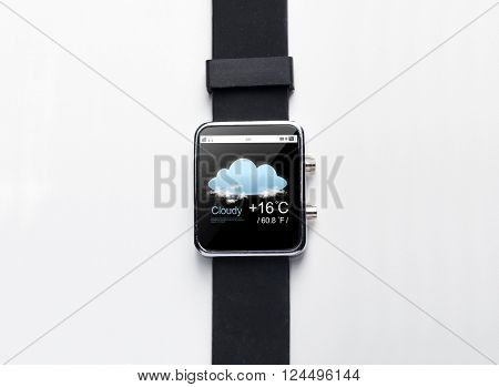 modern technology, weather cast, object and media concept - close up of black smart watch with forecast application