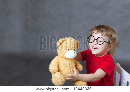 A Child Of 3 Years Old Plays With A Teddy Bear