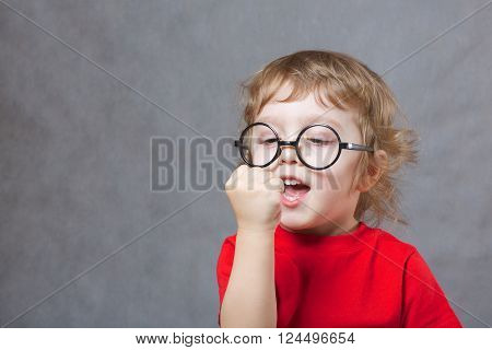 A Boy Shows His Fist. Closeup