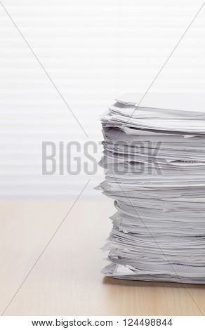 Stack of paper documents on office table