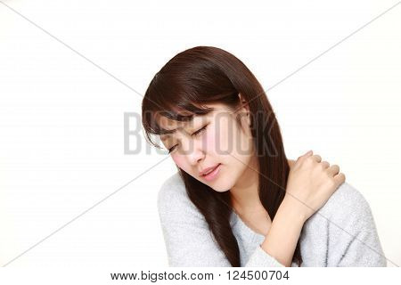 young Japanese woman suffers from stiff neck