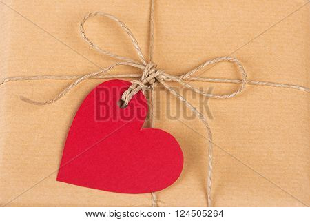 Gift box with blank heart-shaped labels isolated on white