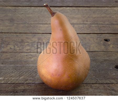 Pear isolated on wood table close up