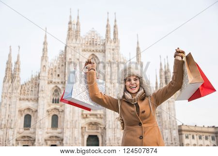 Happy Woman With Shopping Bags Rejoicing In The Front Of Duomo