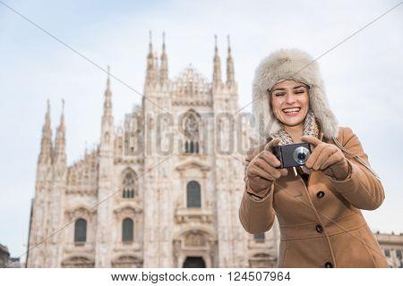 Happy Woman Tourist Taking Photos While Sightseeing Milan