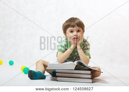 A Boy And A Pile Of Books