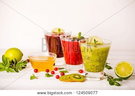 fresh berry smoothies, fruit shake with ingredients. healthy veggie food. no sugar, diet and detox concept.