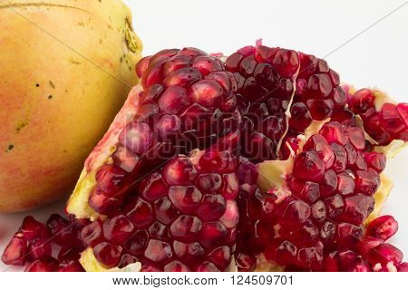 Close up photo of pomegranate seeds isolated on white
