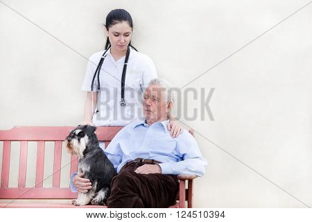 Senior Man With Caregiver And Dog