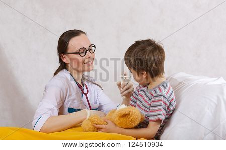 A Child And A Paediatrician In Her Cabinet