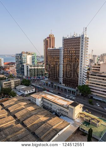 DAR ES SALAAM TANZANIA - MARCH 23 2016: Architecture in downtown of Dar es Salaam Tanzania East Africa in the evening at sunset. Vertical orientation wide angle.