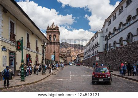Cusco, Peru - September 3, 2015: People and tourists walking in the streets of Cusco, former Inca capital, famous travel destination in Peru and one of the most visited historical cities in the world.