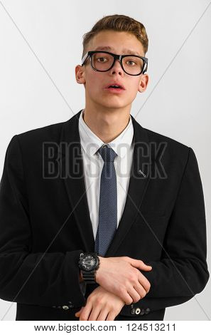 portrait of young stylish businessman on gray background
