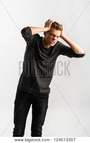 portrait of a male caucasian teenager on gray background