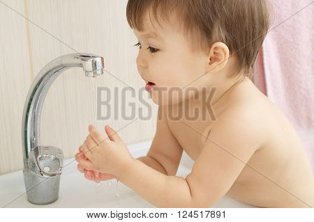 Baby Child Rejoices Water