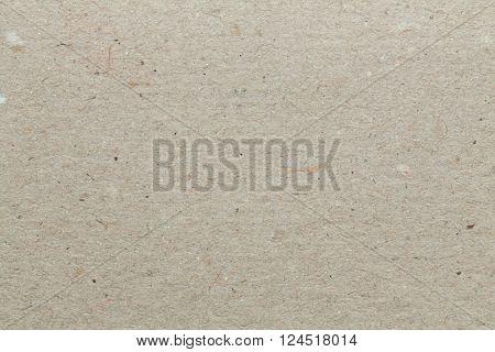 Beige cardboard texture. Beige background.