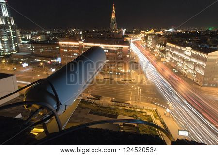 Outdoor Security Camera and night street in Moscow, long exposure, focus on camera