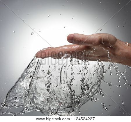 Splash of Water in Woman Hand