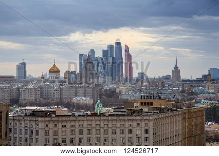 Cathedral of Christ Saviour domes and skyscrapers at evening in Moscow