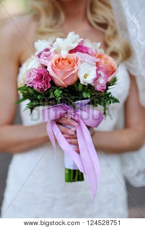 Wedding bouquet in hands of the bride ** Note: Shallow depth of field