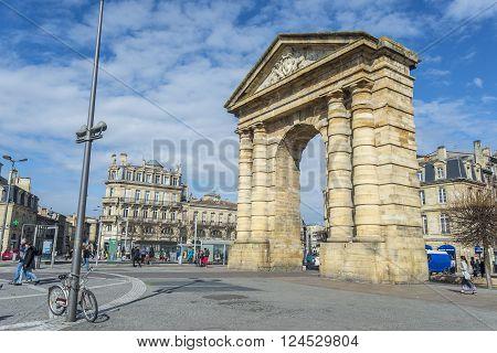 Bordeaux France - March 26 2016. People walking near to Porte d'Aquitaine (local name) Aquitaine gate at Place de la Victoire. Bordeaux France.