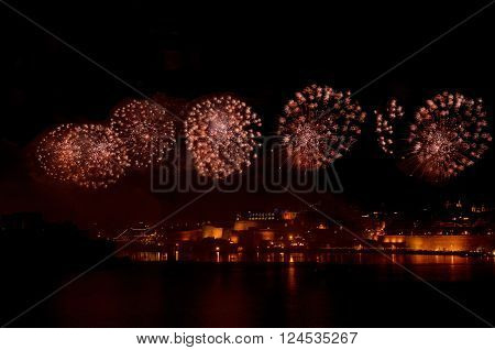 Colourful fireworks in Valletta, Malta, fireworks festival 2015 in Malta, fireworks in Valletta isolated in dark background with the place for text, 4 July, Independence, New Year ** Note: Visible grain at 100%, best at smaller sizes