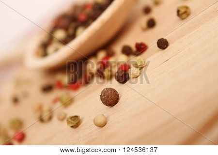 Close-up of spices in wooden spoon on wooden surface