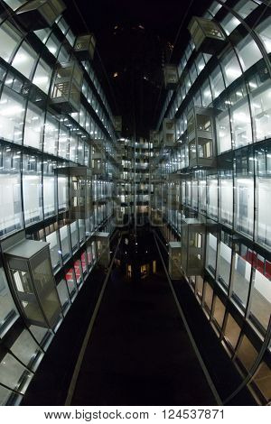 Beautiful illuminated windows with relfection in glass - modern building, fisheye
