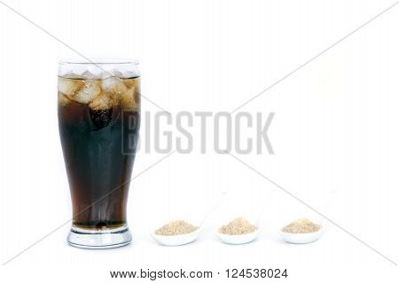 black drink (cola) and sugar over lettuce over white background ** Note: Soft Focus at 100%, best at smaller sizes