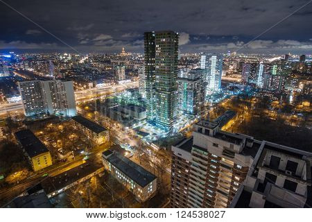 Night view of residential district with illumiantion and cloudy sky in Moscow, Russia