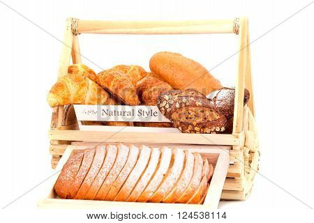 Composition with bread  in basket isolated on white backgound