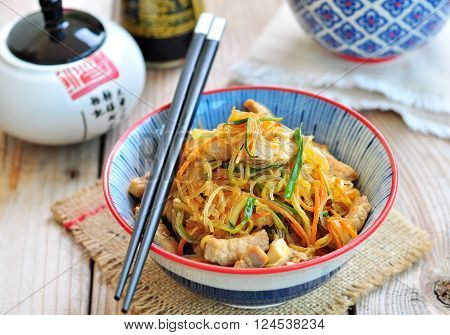 Pork roast with rice noodles, carrots, zucchini, garlic, ginger, green onions, with rice vinegar, soy sauce and sesame oil.