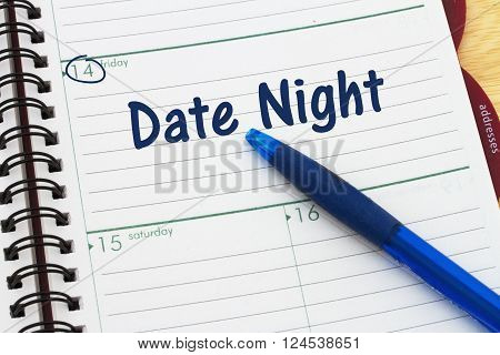 Planning your Date Night, A pen and a day planer with text Date Night