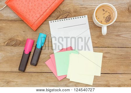 flat lay: green tea and writing in a notebook office set