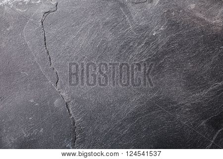 Black stone background. Abstract textured stone grunge surface.