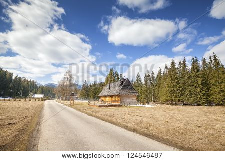 Wooden Hut By A Country Road In Tatra Mountains.