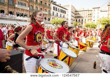 Spain Navarra Pamplona 10 July 2015 S Firmino fiesta girl playing a drum in the main square member of the Spanish school of samba fortalezaspanish school of samba fortaleza