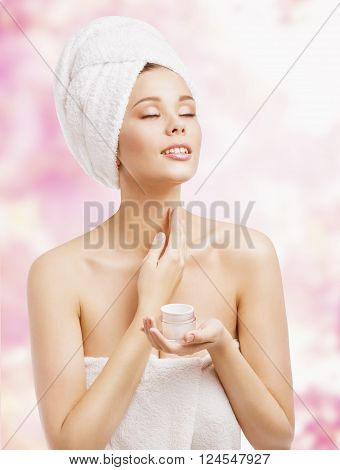 Skin Care Woman Applying Cream in Bath Towel after Spa Treatment Cosmetic Moisturizing Lotion
