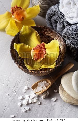 Close up view of spa theme objects on grey background. Orchid flower SPA background