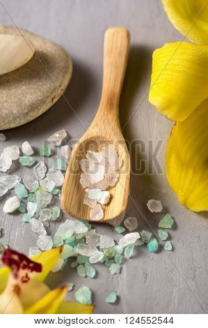 Sea salt on wooden spoon closeup. SPA background