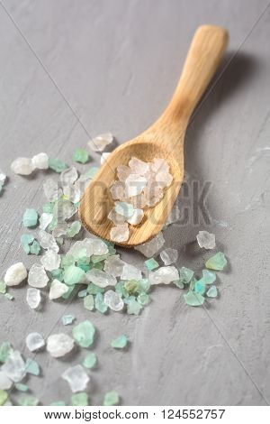 Sea salt on wooden spoon closeup. Shallow DOF