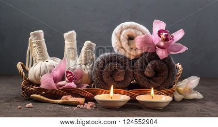 Spa concept with Thai herbal ball sea salt towels and candles