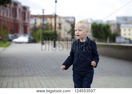 Portrait of a little boy of two years, outdoors