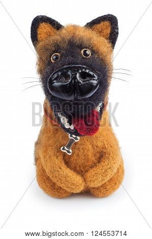 small funny handmade toy ginger dog from felt isolated on white background