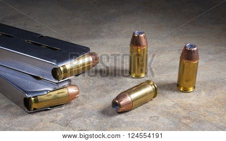 Cartridges for a semi automatic handgun loaded with hollow point bullets