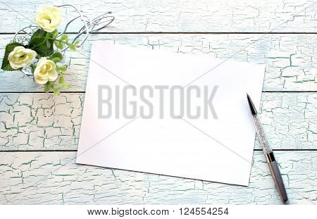 Mockup for presentations with little bicycle blank card and a pen. Desktop workplace designer artist painter top view. Modern trend template for advertising.