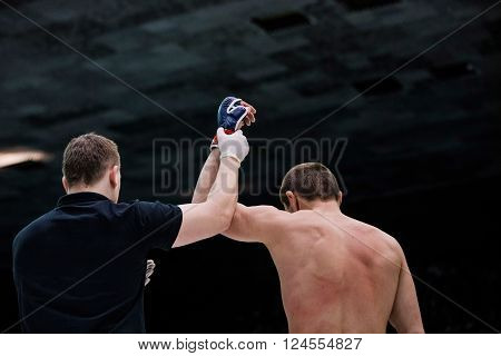 Chelyabinsk, Russia - April 3, 2016: judge announces winner of fighter of fight in ring in Boxing during Championship of mixed fighting single combats