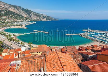 View of shoreline and red roofs of Menton - small town on French Riviera.